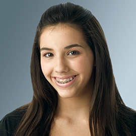 Picture of a young smiling girl with braces